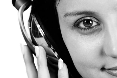 Close-up of girl with headphone on her head - black and white, shallow DOF photo