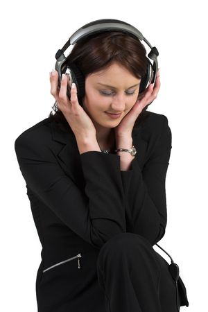 woman in formal black suit, headset on head, listening to music - eyes closed photo