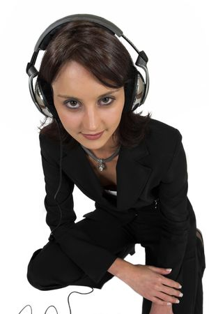 Business woman in formal black suit with headphones on head photo