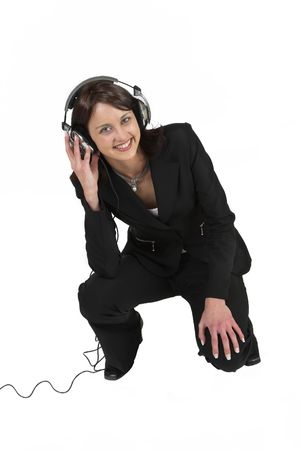 Business woman in formal black suit with headphones on her head photo