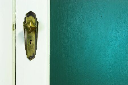 Door knob and green wall - copy space Stock Photo - 258437