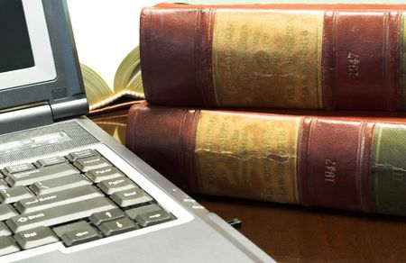 Laptop and Legal books on table - South African Law Reports Stock Photo