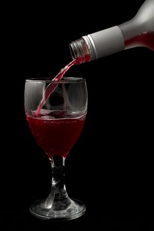 Wine is being poured into a glass - black background Stock Photo - 262796