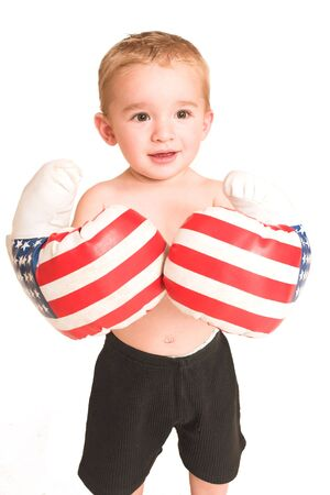 Todler standing with big boxing gloves. Stock Photo - 269320
