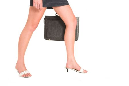 Business woman walking, holding a leather suitcase - copy space Stock Photo - 269309