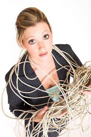 cables: Business woman tangled up in cables - looking up