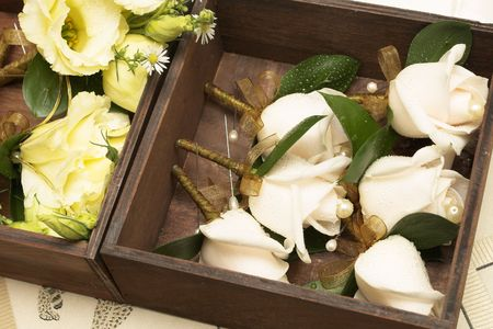 Wedding - corsages in a brown wooden holder Stock Photo - 272402