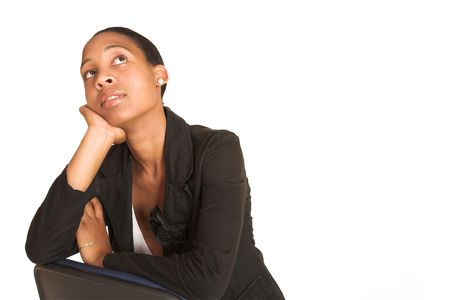 African business woman dressed in black jacket. Sitting on office chair, thinking. Copy space