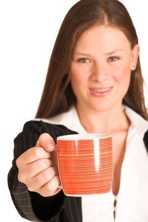 Business woman dressed in a pinstripe suit, holding a mug.  Shallow DOF - mug in focus, face out of focus photo