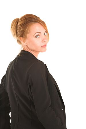 Blonde business lady in formal black suit.  Looking over her shoulder.  Portrait photo