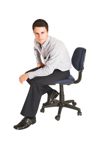 mascular: Businessman sitting on office chair.