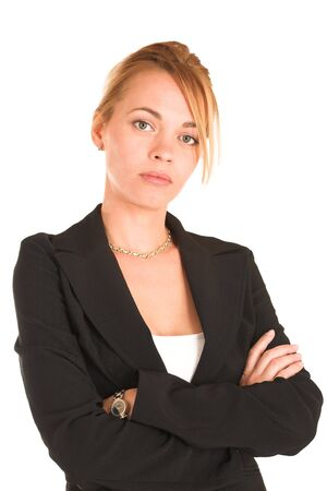 Blonde business lady in formal black suit.  Portrait, standing with arms crossed photo