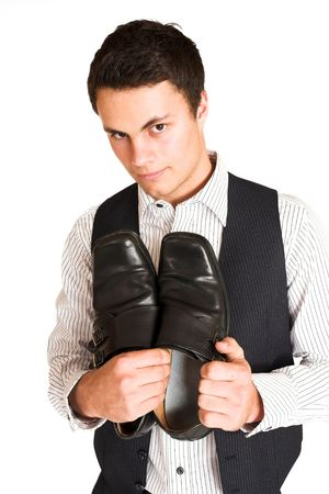mascular: Businessman standing, holding his shoes. Stock Photo