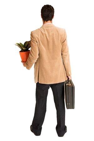 Businessman holding pot plant and leather suitcase. photo