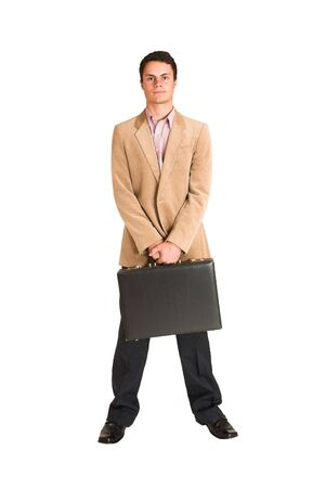 Businessman standing, holding a black leather suitcase. photo