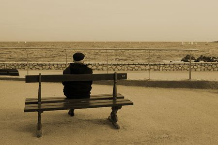 Man on Bench, next to the sea, Sepia, Vintage, High Key photo