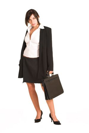 pencil skirt: Business woman dressed in a pencil skirt and jacket. Holding a black leather suitcase.