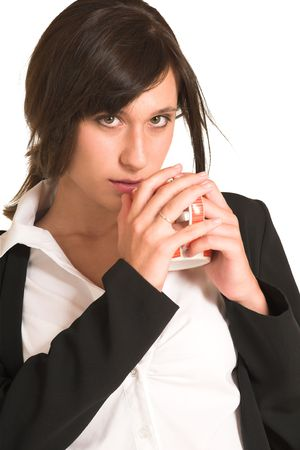 pencil skirt: Business woman dressed in a pencil skirt and jacket.  Drinking out of a mug.