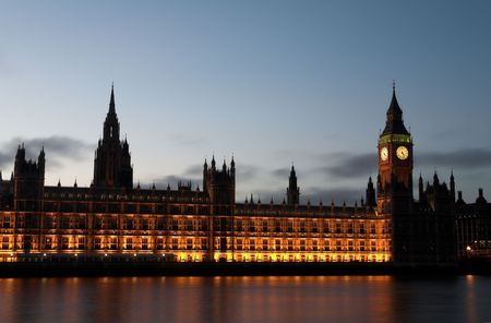 Big Ben and the house of parliament just after sunset on the river Thames photo