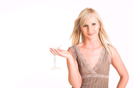 Blond business woman dressed in a beige top, holding a martini glass - copy space Stock Photo - 310523