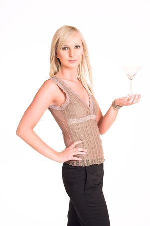 Blond business woman dressed in black trousers and a beige top.  Holding a martini glass. Stock Photo - 311320