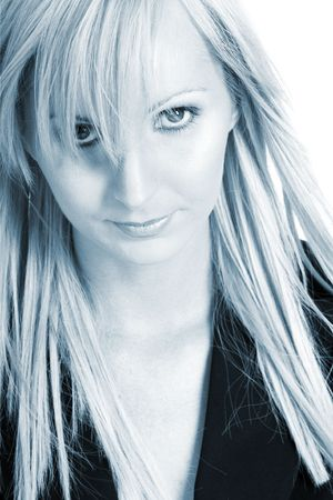 Blond business woman dressed in black trousers and a black shirt.  Blue tone photo. photo