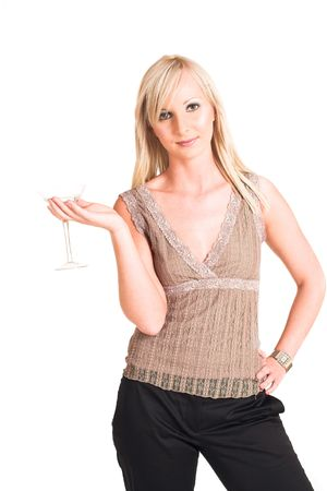 Blond business woman dressed in black trousers and a beige shirt.  Holding a martini glass photo