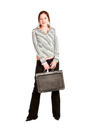Business woman with brown hair, dressed in a white shirt with black stripes. Holding a black leather suitcase Stock Photo - 311295