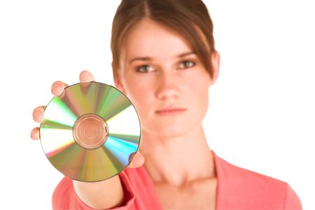 informal: Brunette business woman in  an informal light pink shirt.  Holding a CD Stock Photo