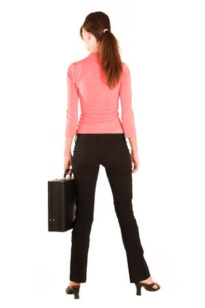 Brunette business woman in  an informal light pink shirt and black trousers.  Holding a black leather suitcase. Stock Photo - 327547