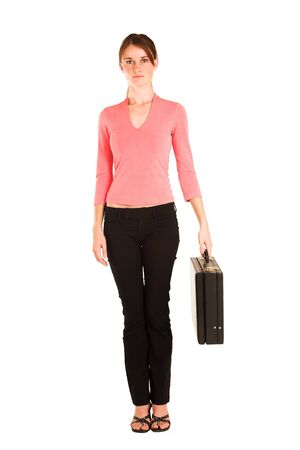 Brunette business woman in  an informal light pink shirt.  Holding a black leather suitcase. Stock Photo - 327548
