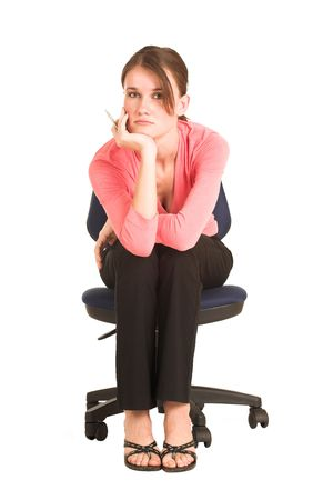 brunette business lady in pink top. Sitting on an office chair photo