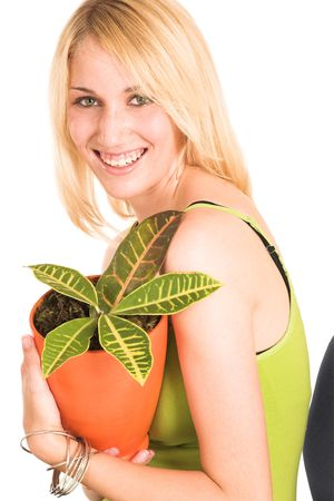 informal: Blonde business lady in an informal green top. Holding a pot plant, lauching. Stock Photo