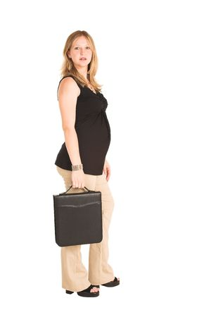 Pregnant Business Woman, wearing black top and beige pants.  Standing, holding leather file suitcase. photo
