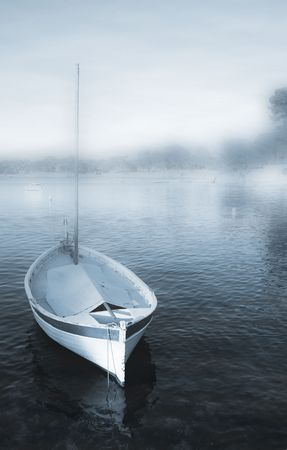 A yacht floating  in Antibes, France.   Blue tone.  Misty.  Digital Artwork.  Copy space. photo