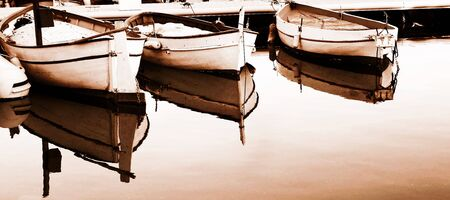 A yacht floating  in Antibes, France.   Sepia tone.  Digital Artwork.   Copy space. photo