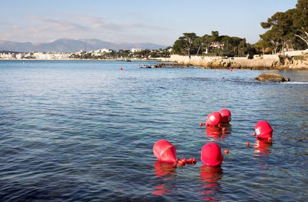 Buoys floating on the ocean in Antibes, France - NO DIVING. Copy space. Stock Photo - 376963