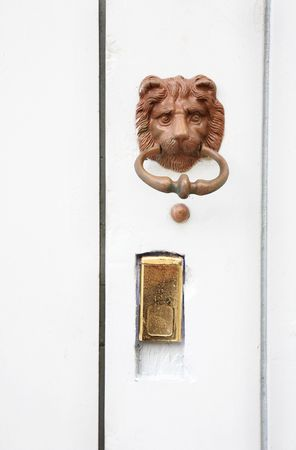 Knocker in the form of a lions head on a door in Antibes, France.  Copy space. photo