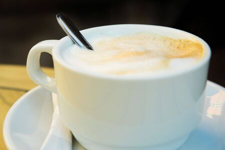 dof: Cappuccino Coffee and spoon - Shallow DOF, focus on Foam