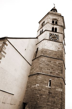 Tower of a church in Kirchberg, Germany.  Sepia tone. photo