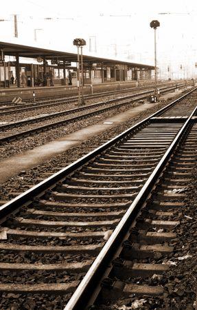 Trainstation in Neurenburg, Germany.  Movement on person walking.  Sepia tone. photo