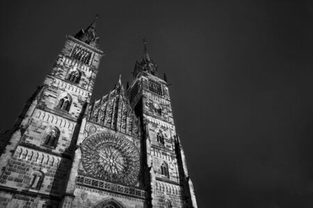 masonary: Church in Neurenburg at nighttime. Black and white. copy space. Stock Photo
