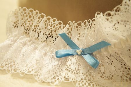 shallow: Close-up of a wedding garter.  Shallow D.O.F