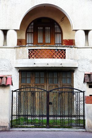 Gate and door of a building in Antibes, France. photo