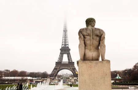 A statue in the foreground with the Eiffel Tower in Paris, France.  Copy space. Stock Photo - 453356