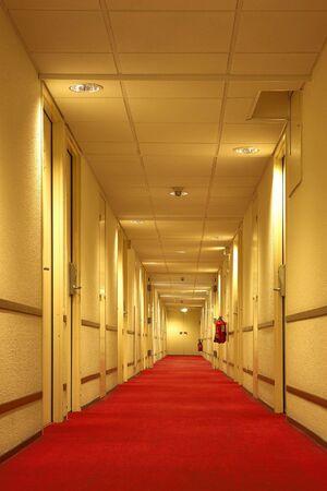 Red carpet of the hotel corridor photo