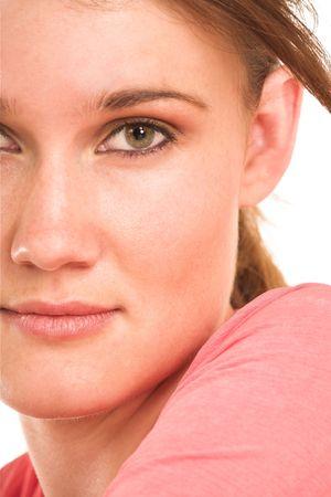 Brunette business woman in  an informal light pink shirt.  Close-up.  Half face photo