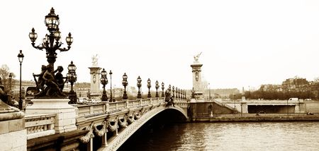 winters: Pont Alexandre III - Bridge in Paris, France.  Movement on cars driving � Gloomy winters day. Copy space, sepia tone