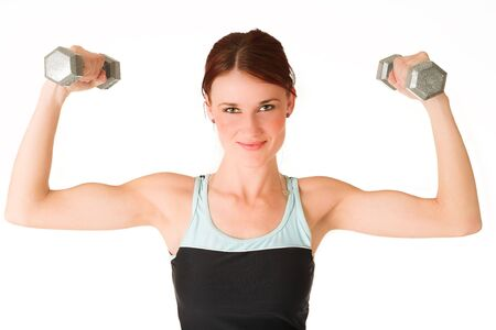 muscle woman: A woman in gym clothes, holding weights. Stock Photo