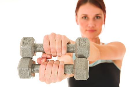 A woman in gym clothes, holding weights out in front of her.  Shallow DOF – face out of focus, weights and hands in focus Stock Photo - 466032